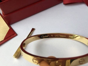 Cartier Love yellow gold bracelets were stamped with serial numbers and logo